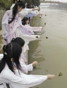 Throwing zongzi into river