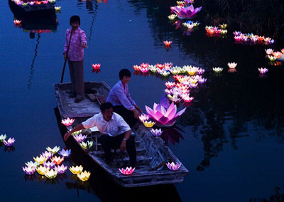 Water lanterns being set on a river at the Ghost Festival, the 15th day of the 8th lunar month.