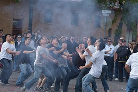 Youths competing to grab the good fortune ring. Credit: Bok Kai Temple.